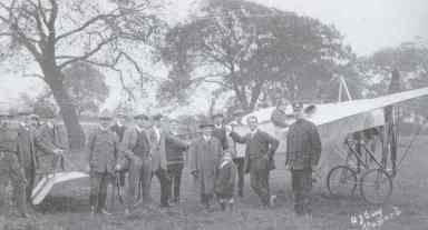 With Gustav Hamel on Lammascote Field, 1912. Mitchell is third from the right leaning against the plane. (Staffordshire County Museums Service)
