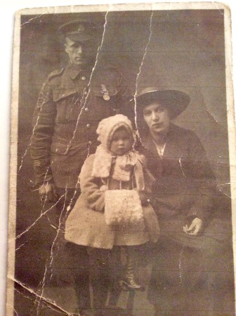 William Coram wearing his Military Medal, 1916, with his wife Kate Clews and daughter Kathleen (picture courtesy of Vanessa Green and Brian Key, descendants of William & Kate Coram)