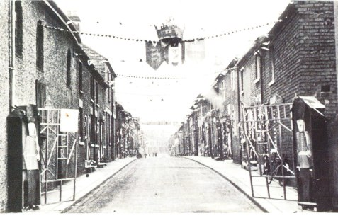 New Street where the Concars lived. The photo was taken during the Coronation celebrations, 1953 (courtesy of the late Roy Mitchell). The Concars lived in one of the houses on the left in the middle distance.
